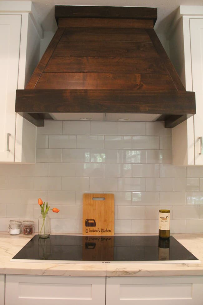 The wooden vent hood over the induction stove.
