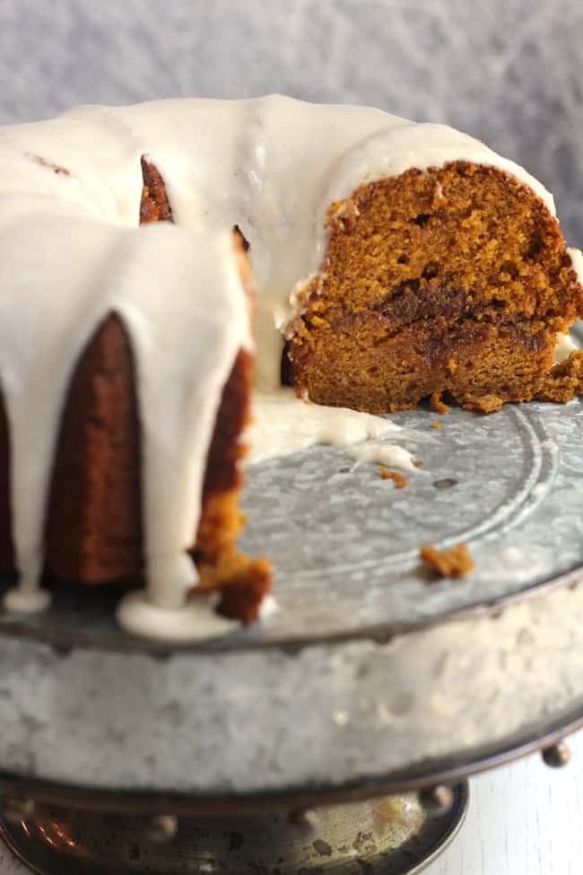 Side shot of the inside of a pumpkin streusel Cake on a gray cake plate.