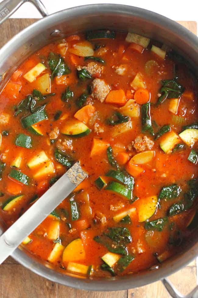 Overhead shot of a stock pot of sausage vegetable soup.