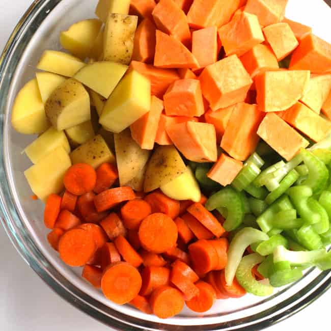 Overhead shot of a bowl of veggies, on a white background.