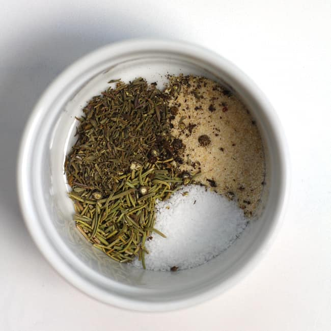 A small bowl of spices used for creamy wild rice soup.