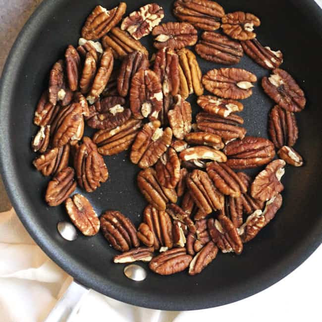 Small saucepan of toasted pecans.