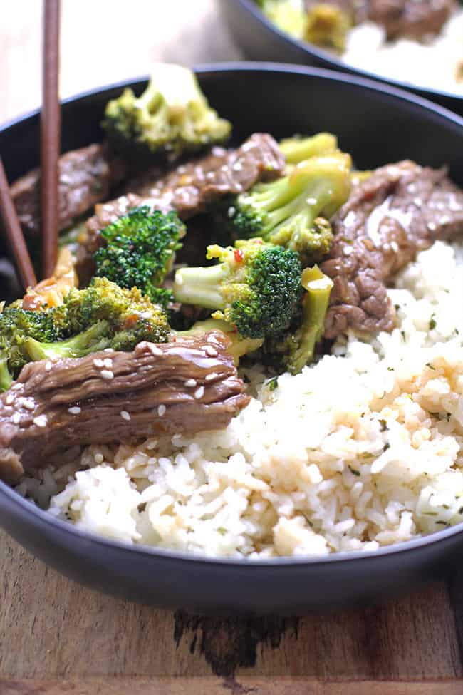 Side backlit shot of beef and broccoli over rice.