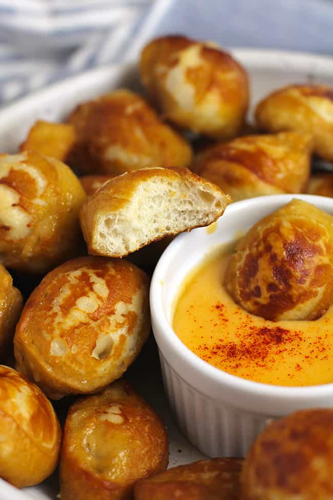 Closeup shot of a bowl of homemade pretzel bites, with a bite out of one of them.