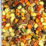 Overhead shot of a sheet pan of roasted sheet pan gnocchi with sausage and vegetables.