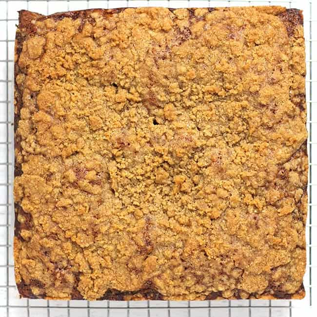 Overhead shot of the baked coffee cake on a cooling rack.