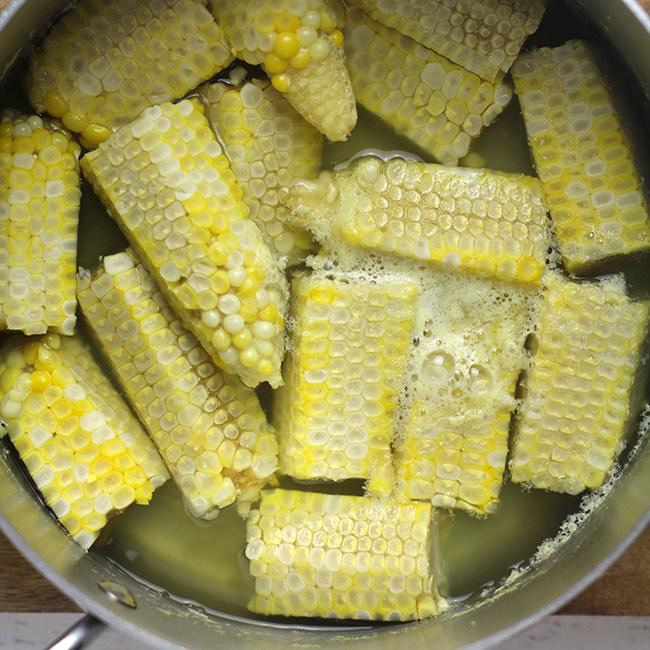 Pot of boiled corn cobs.