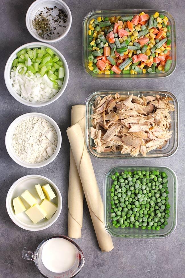 Ingredients for chicken pot pie, in individual bowls.