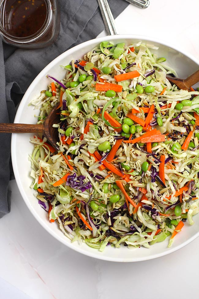 A large white bowl of Asian cabbage salad.