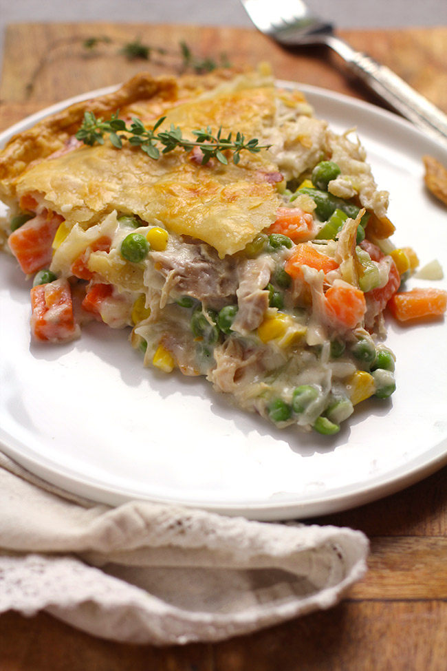 Side view of a slice of chicken pot pie.