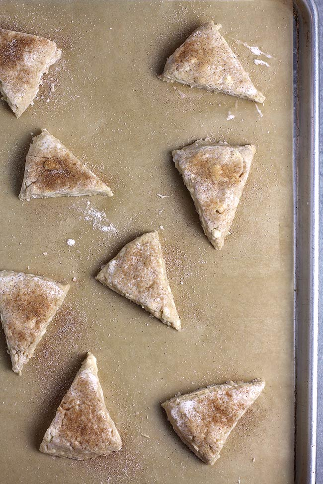 The scone triangles before baking, on a baking sheet.