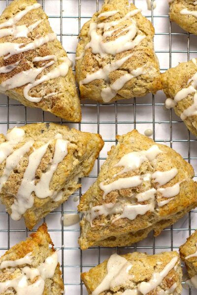 Several snickerdoodle scones on a cooling rack.