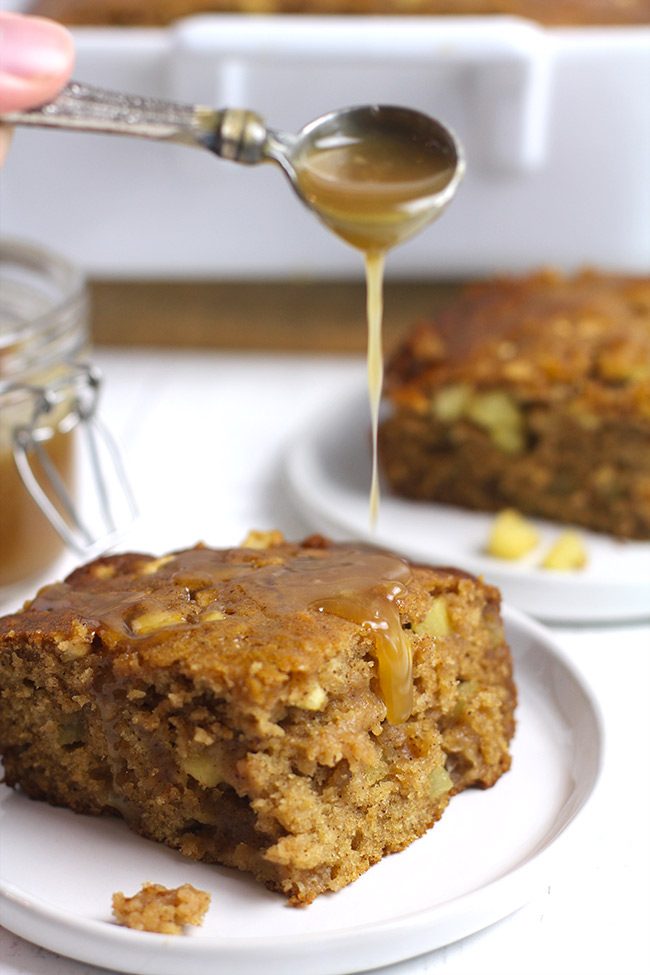 Slices of apple spice cake with a drizzle of caramel sauce.