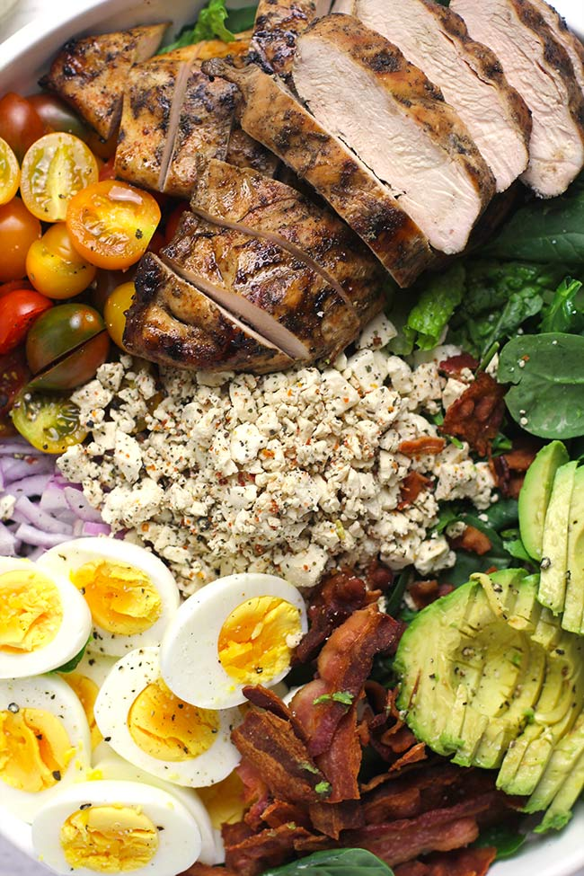 A closeup of grilled chicken Cobb Salad.