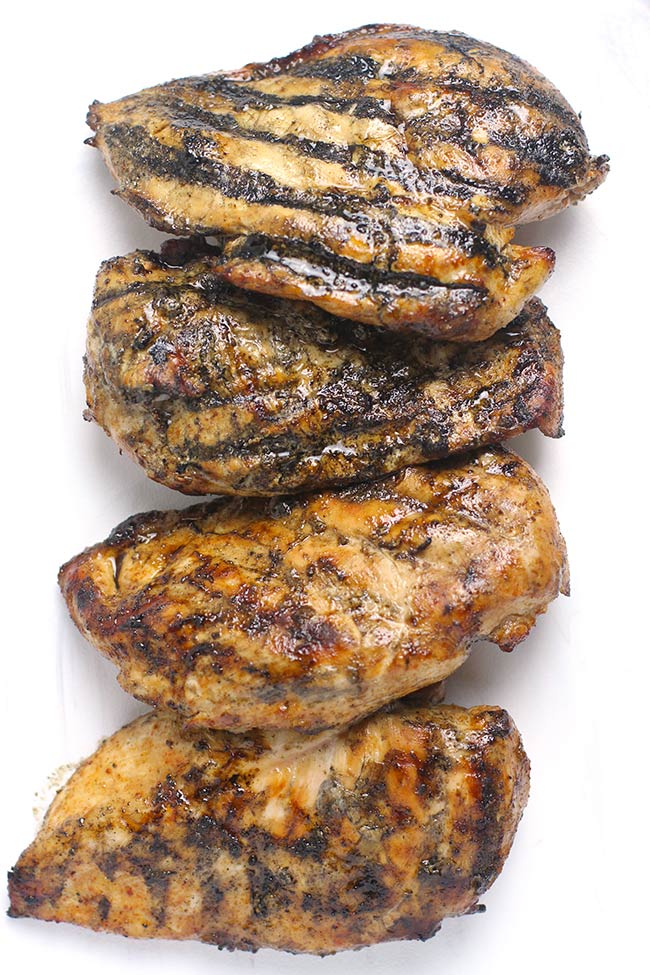 A platter of just grilled chicken breasts.