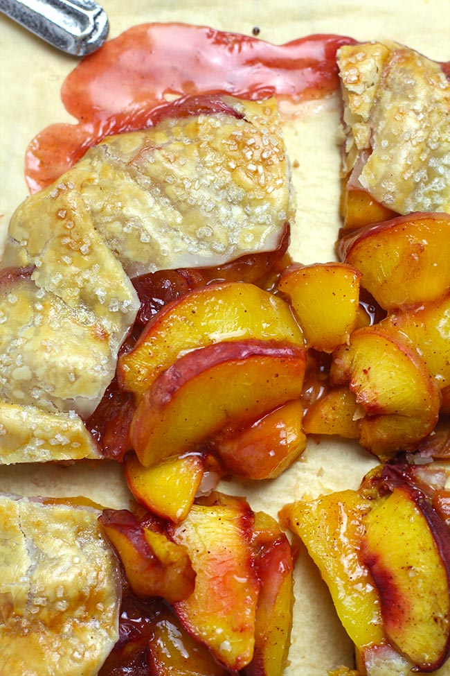 Closeup of a sliced peach galette.