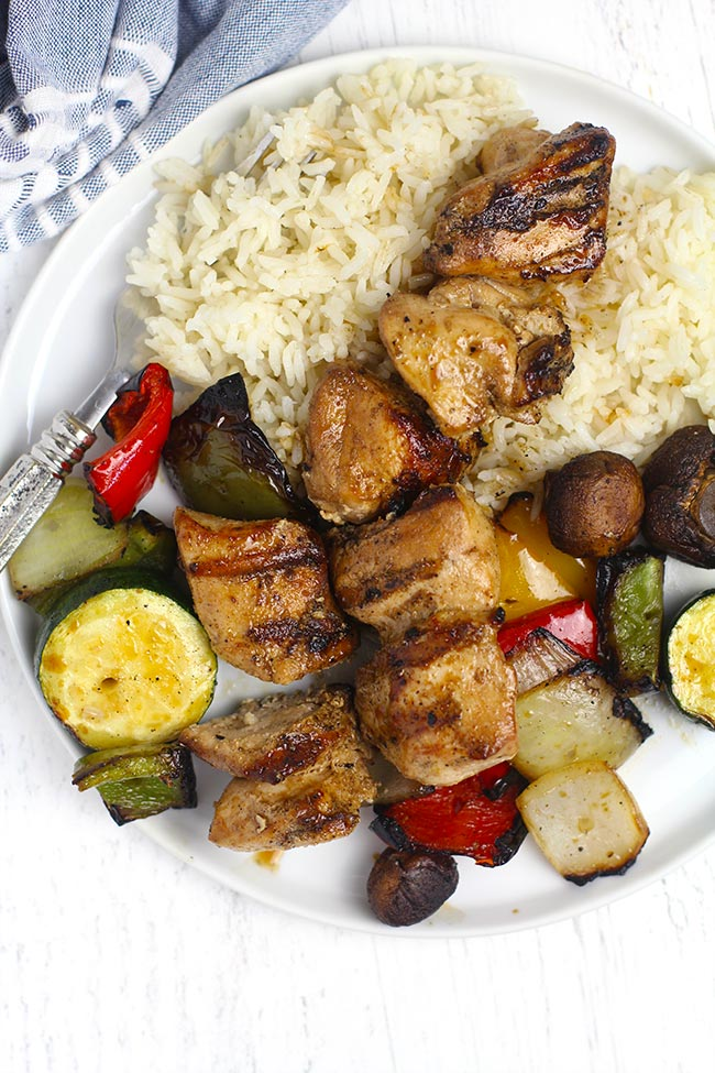A serving of rice, veggies, and grilled chicken chunks.