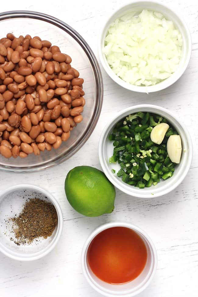 The ingredients for refried beans, in small bowls.