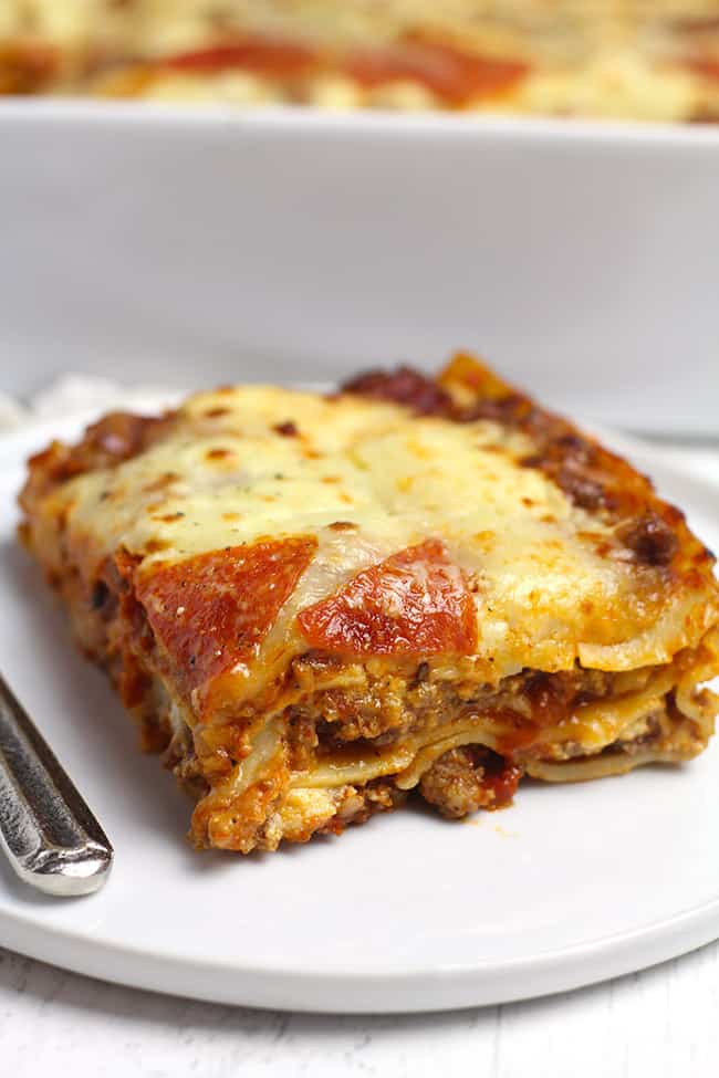 Side shot of a large piece of lasagna.