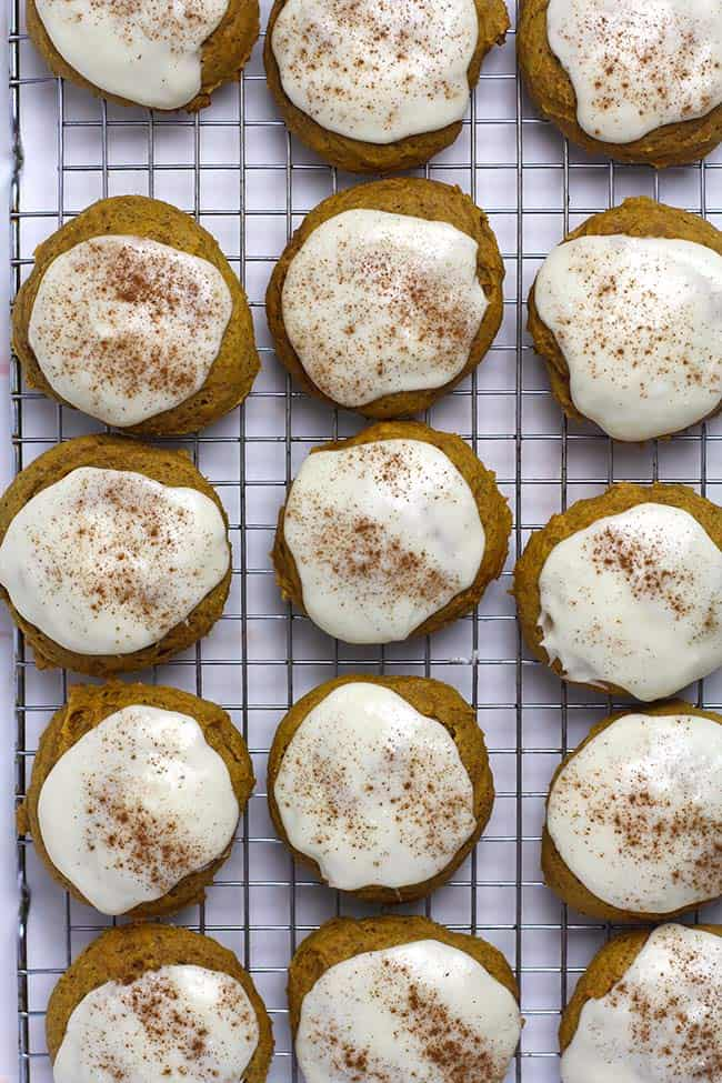 Iced Pumpkin Cookies on a cooling rack.