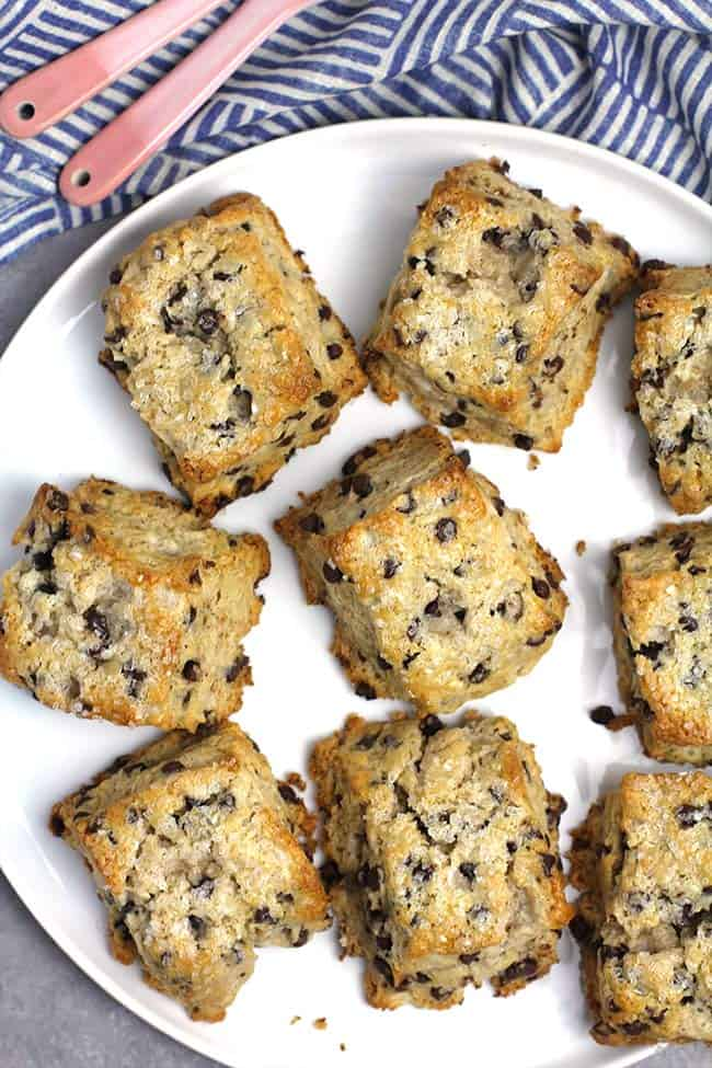 A white plate full of mini chocolate chip scones.