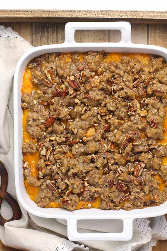 A square casserole dish of sweet potato casserole.