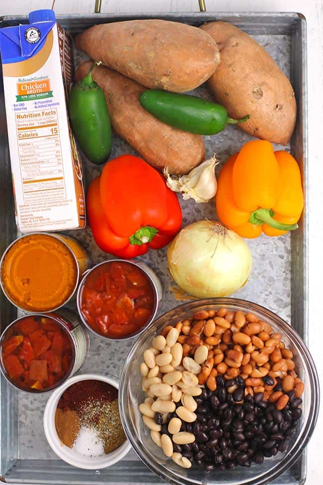A gray tray with the ingredients for the chili.