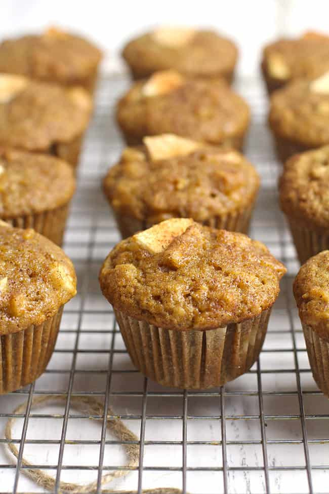 A bunch of the applesauce cinnamon muffins on a cooling rack.