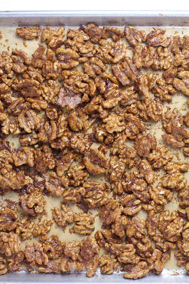 A baking sheet with some just baked candied walnuts.
