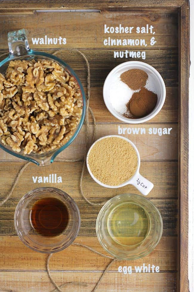 A wooden tray with all the ingredients for the best candied walnuts recipe.