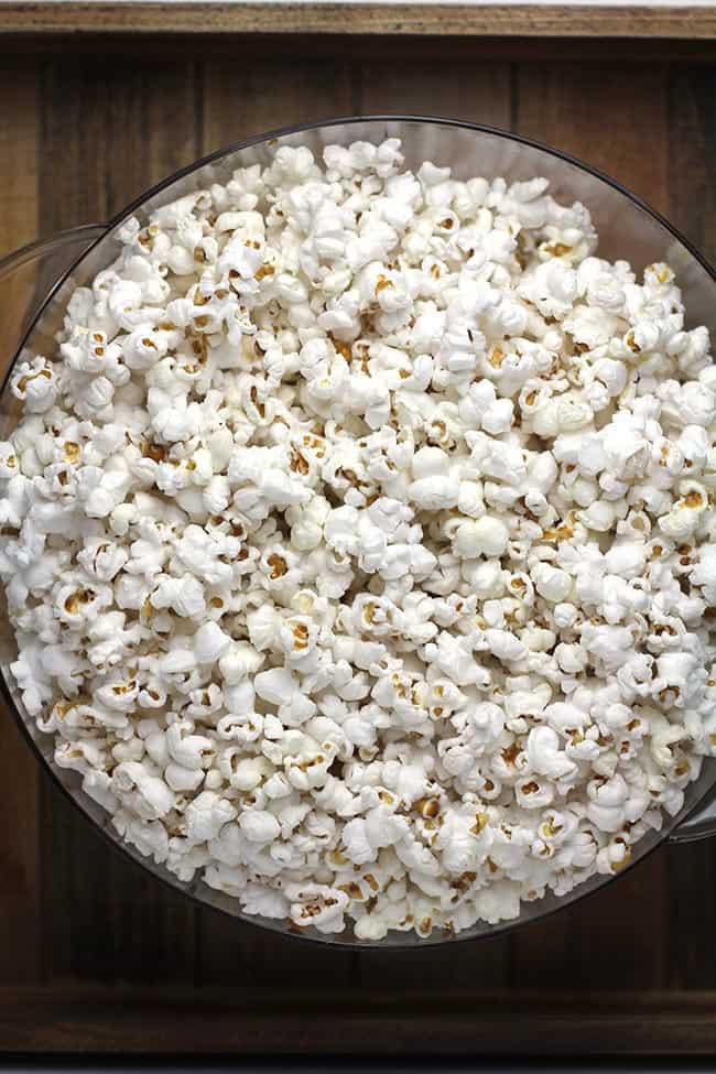 A large bowl of popcorn in stir crazy lid.