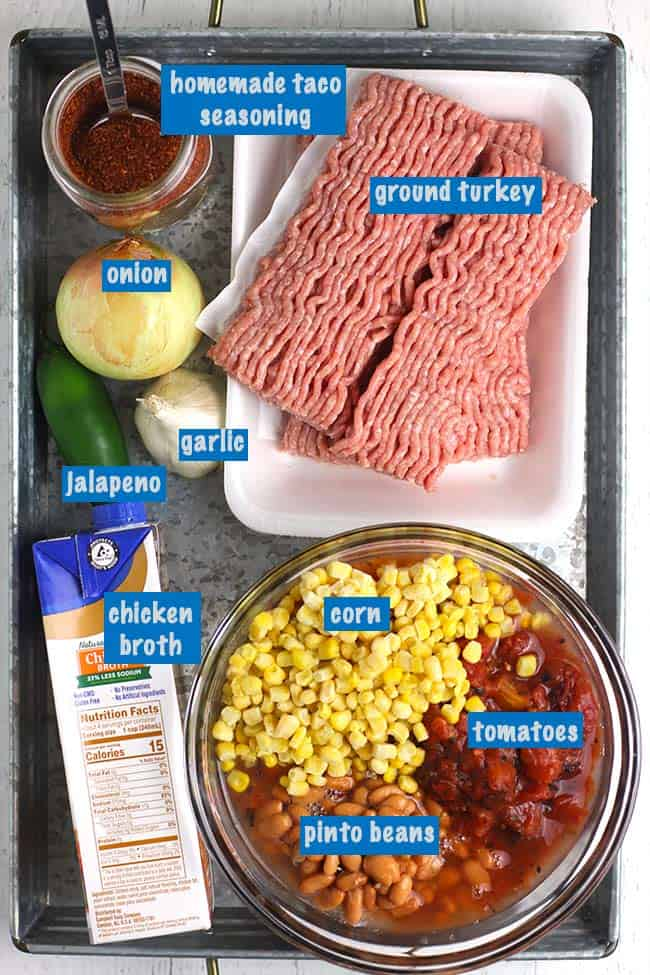 A gray tray filled with all the ingredients for turkey taco soup.