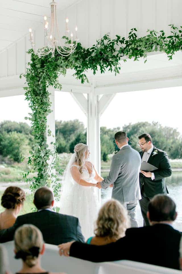 Josh and Tiffany saying their vows at the Grand Ivory.