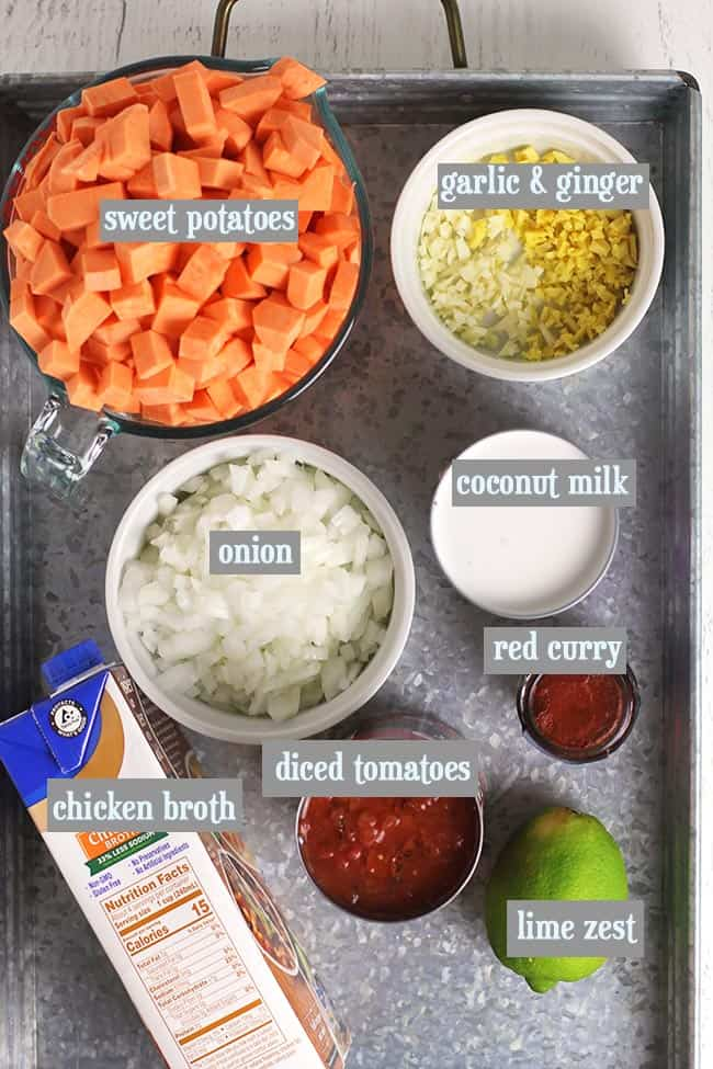 A gray tray with all the soup ingredients with labels.