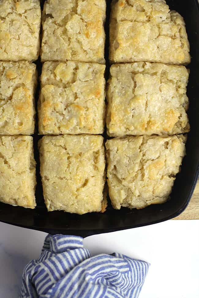 A cast iron skillet with just baked homemade buttermilk biscuits.