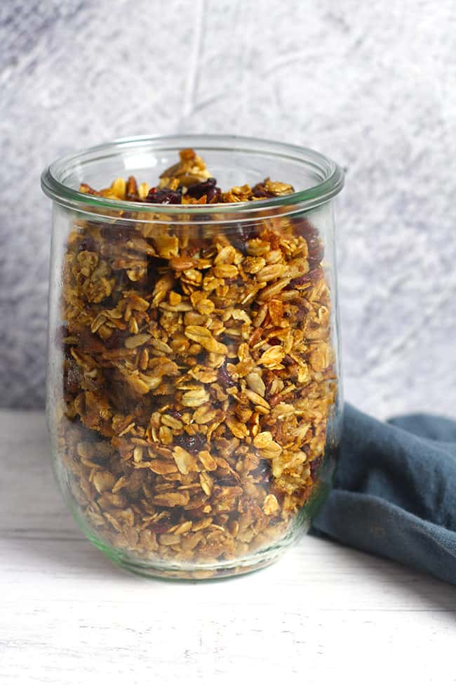 Side shot of a jar of homemade granola.