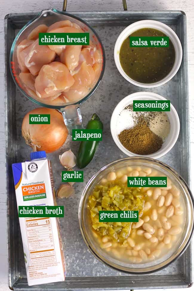 A gray tray with all of the ingredients for this soup.