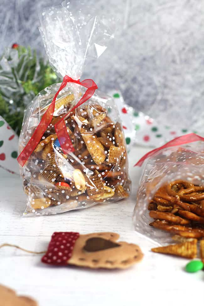 Some spicy Chex party mix in Christmas bags.