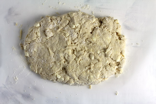 Overhead shot of the biscuit dough in a rectangle.