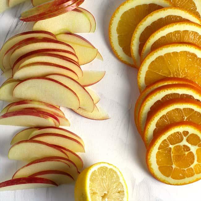 Sliced apples and oranges.
