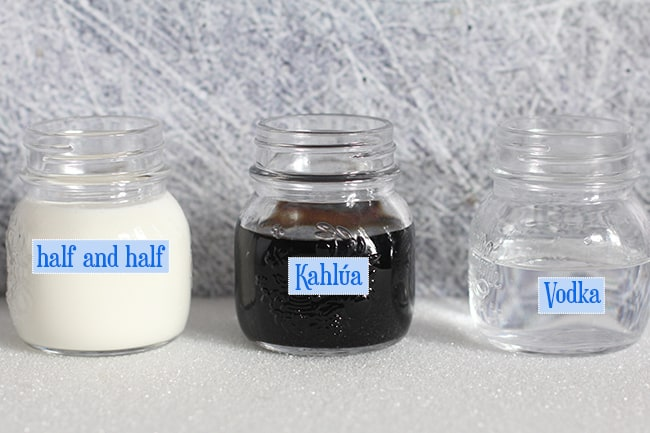 Three small jars with the drink ingredients inside, and labeled.