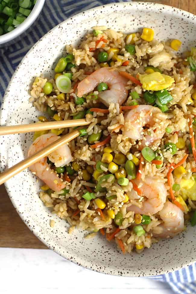 Closeup on a bowl of shrimp fried rice.
