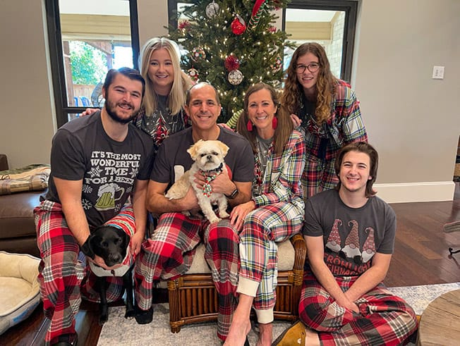a family Christmas photo by the tree.