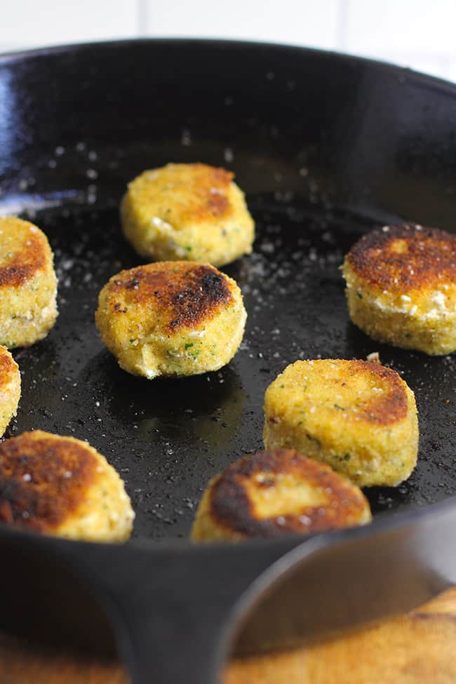 A cast iron skillet with the just-fried goat cheese.