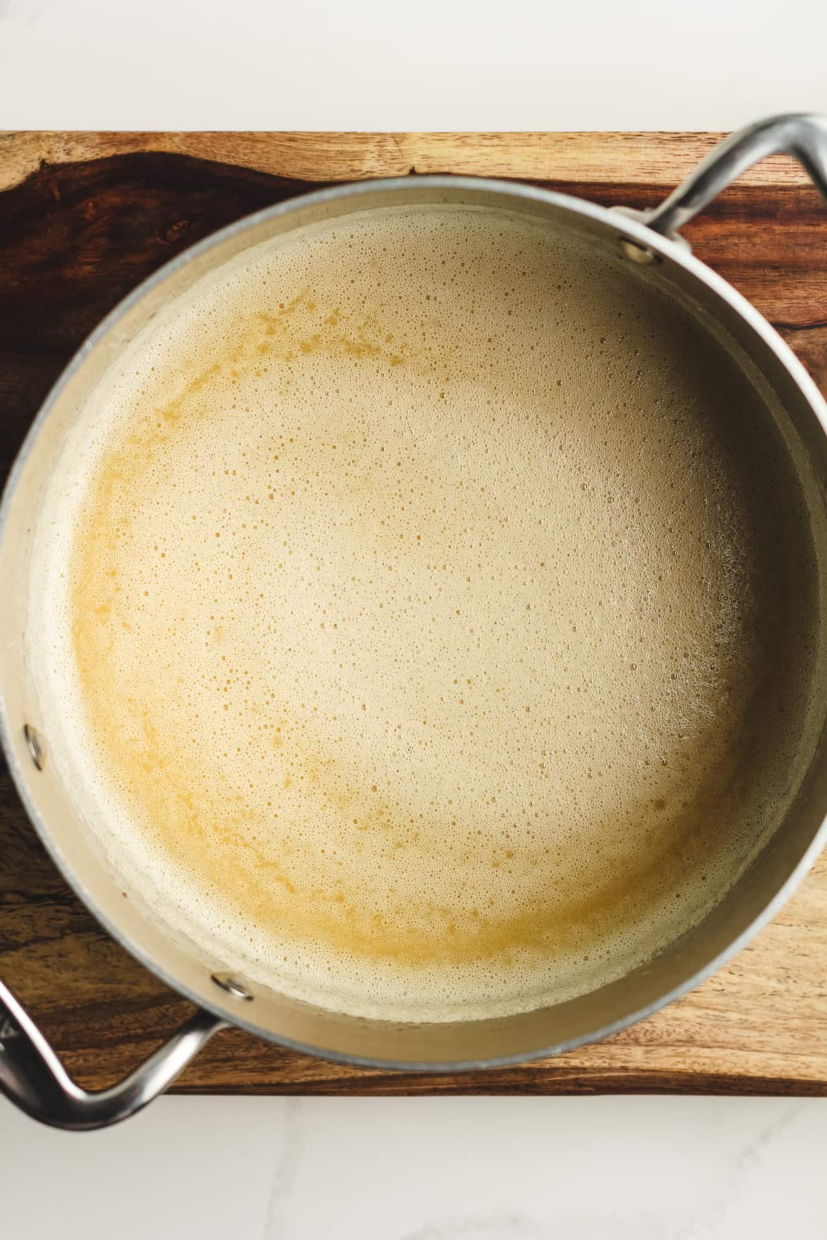 A pan of the browned butter with the tempered eggs.