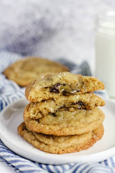 A stack of caramel stuffed cookies, showing the insides.