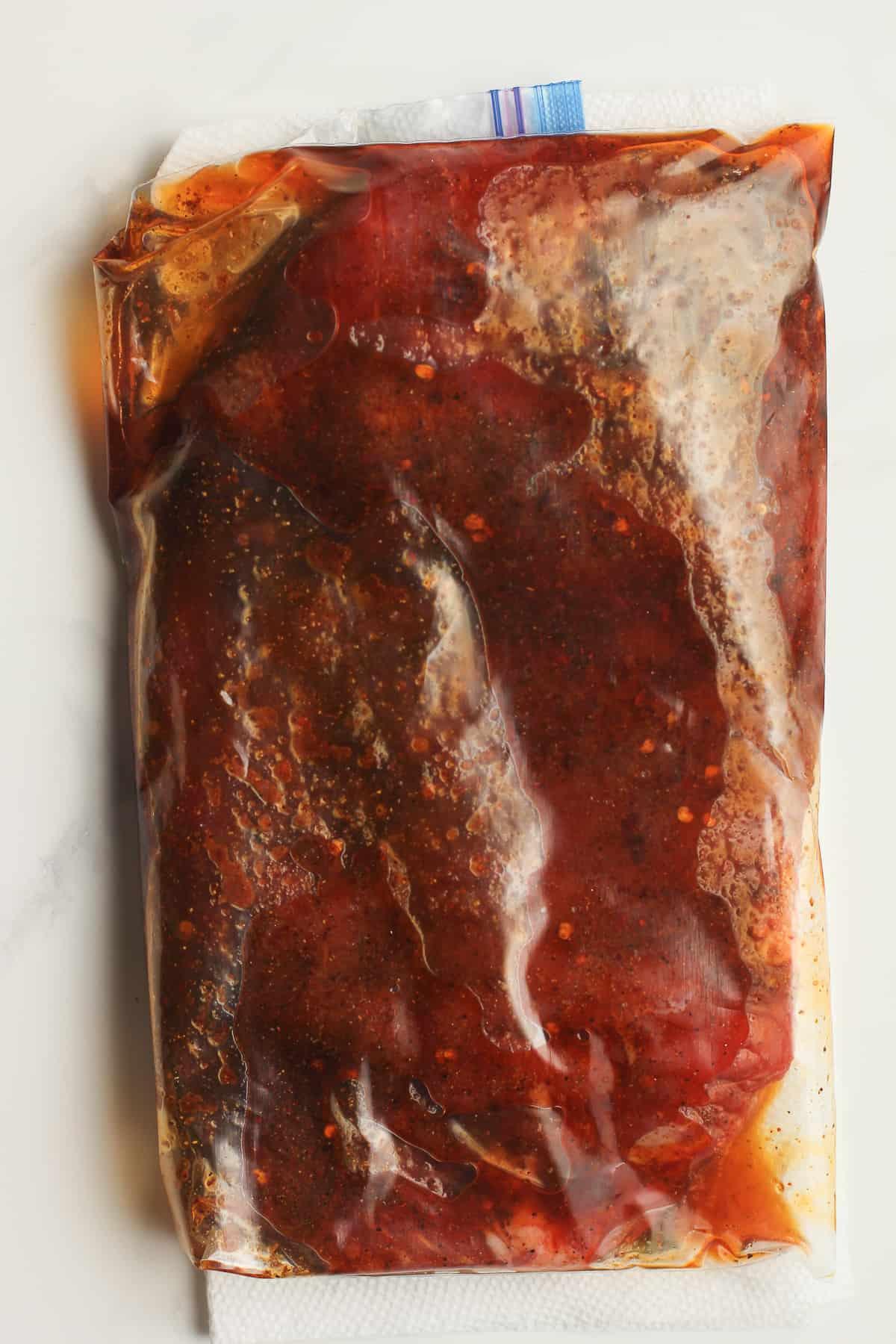 A bag of marinated flank steak.