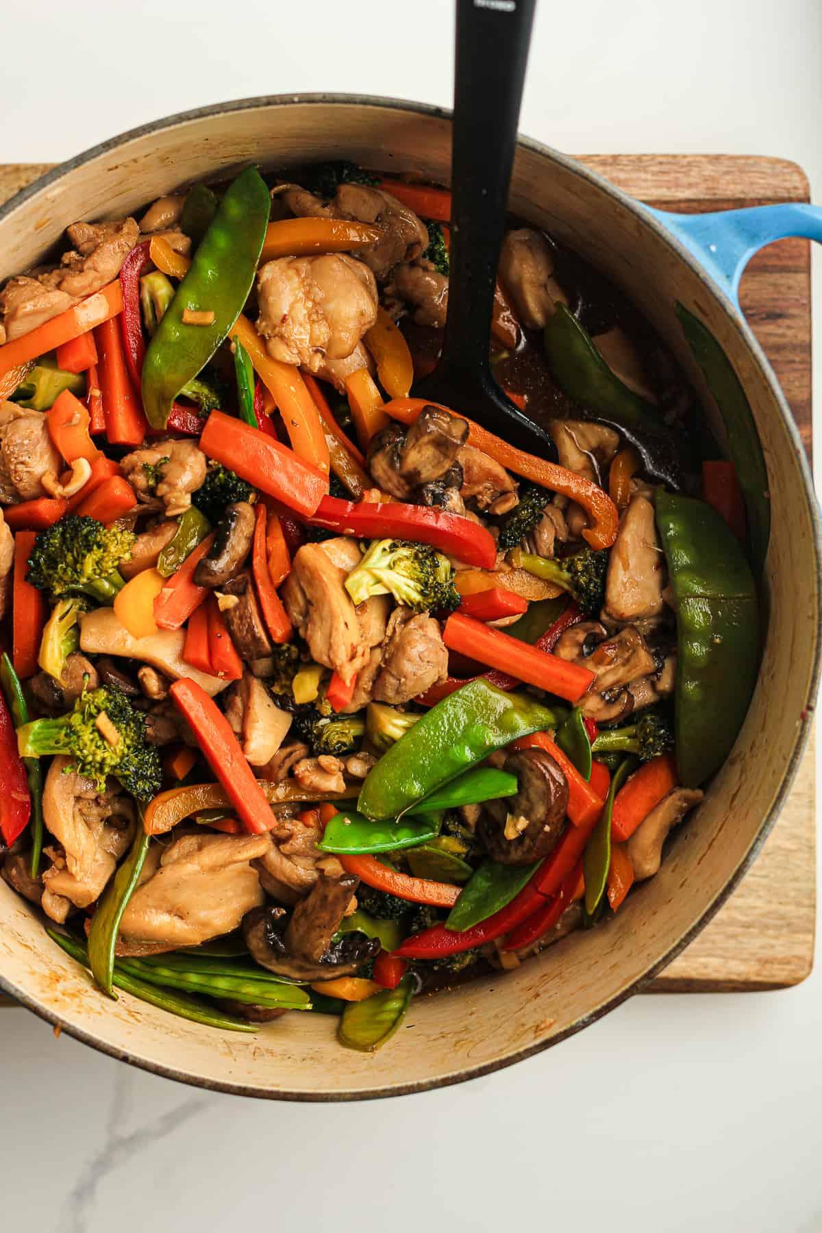 Closeup of a stock pot of chicken veggie stir fry.