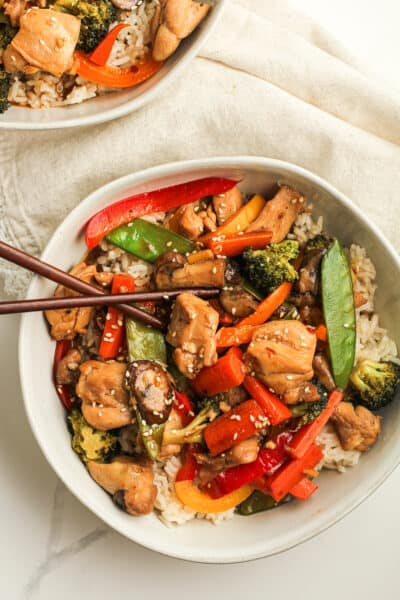 Closeup shot of a bowl of chicken veggie stir fry.