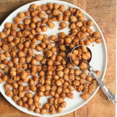 A plate of crispy chickpeas, with a tablespoon.